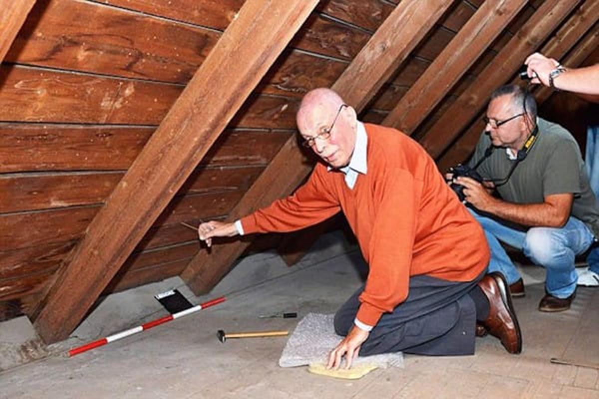 "Pic shows: Rudi Schlattner in the attics.  This is the moment an elderly man was temporarily reunited with family property that had been hidden when he was a 13-years-old and his family were evicted in one of largest mass expulsions the world has ever seen.  Rudi Schlattner was forced to flee the family home that had been built by his merchant father after the end of World War II as part of a mass expulsion of Germans from Czechoslovakia after World War II.  The destruction of World War II had caused enormous hatred in Czechoslovakia of its ethnic German population, and the government under Czechoslovak President Edvard Benes ordered the ""final solution of the German question"" by evicting all ethnic Germans from the country.  Thousands died during the forced expulsions of 1.6 million ethnic Germans their homes and into the American zone West Germany. These were the fortunate ones, and a further 800,000 were sent to the Soviet zone.  Rudi and his family were among those that ended up in the American zone, and before they left they had time to hide their property in the attic of the family home.  He said ""We thought we would one day return, and that would find a property there.""  Now in his 80s, he realised that this would now never happen and has now returned to make sure that even if he is not allowed to have the family property back, at least it will not be forgotten and wanted to make sure people understood who it once belonged to and why it was there.  He contacted municipal officials in the village of Libouch in north-western Czech Republic who used the family home now as a kindergarten, and where it was a revelation that the items had been hidden in the roof of the refurbishments carried out including the roof.  But Rudi's father had done such a good job of hiding it, that nobody had discovered them.  He said: ""My father built the villa in 1928 and 1929. He always thought that one day we would return and get it back.""  He was accompanied on the visit to the building by employees of a museum in the nearby town of Usti nad Labem together with the mayor of Libouch, manager of the kindergarten, archeologist and employees of the museum.  After 70 years it was hard for him to find the exact hiding place, but the 70 packages were eventually found under the roof.  Museum assignee Tomas Okurka told Czech daily newspaper Blesk: ""Mr Schlattner was tapping the roofís boards with a small hammer. All of them had the same sound. Then he tried to find a string which was supposed to detach the boards which was a system set up by his father.  ""He told his son that he would only have to pull the string in order to detach the boards and suddenly he found the string, and when he pulled it two boards detached and the shelter full of objects untouched for 70 years appeared.  ""It took too long and we thought that the shelter had perhaps been discovered and the items removed during the roof reconstruction and we would not find anything. But suddenly he found the string.""  He added: ""The packages were very skilfully hidden in the vault of a skylight. It was incredible how many things fitted in such a small space. It took more than one hour until we put everything out.""  There were some packages wrapped in brown paper and some unwrapped objects such as skis, hats, clothes-hangers, newspapers and paintings by Josef Stegl who also lived in the house during WWII.  Mr Okurka said: ""We were surprised that so many ordinary things were hidden there. Thanks to the circumstances these objects have a very high historical value.""  Because when the Germans were expelled all of their property was also confiscated, the items in the attic remain under the ownership of the Czech government.  All the packages were taken to a museum in the town of Usti nad Labem where they have been unpacked, analyzed and filed.  So far several packages have been unpacked. Some umbrellas, hats, badges, paper weights, paintings, pens, school tables, unpacked cigarettes, socks, books, sewing kits and much more. Everything was in very good condition according to the historians.  Manager of the museum Vaclav Houfek said: ""Such a complete finding of objects hidden by German citizens after the war is very rare in this region.""  Because they are the property of the Czech Republic their previous owner cannot claim them back. It is not yet been decided which institution will take the objects.  Mr Schlattner is reportedly not bitter over the fact that his family's treasures cannot be returned to him and promised to help with identification of the objects, although his health is not good.  Tomas Okurka said: ""We can get details and a very strong personal story by talking to him about them.""  (ends)"
